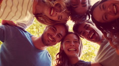 Happy friends smiling at camera in the park Stock Footage