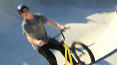 BMX rider performing crazy tricks in skate park Stock Footage