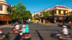 Hoi An - May 2015: Ancient city junction street view with people and traffic. 4K Stock Footage