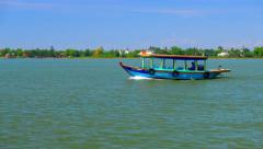 Hoi An - May 2015: River view with local boat. 4K resolution. Vietnam Stock Footage