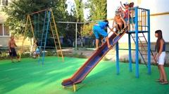 Russia, Primorsko-Ahtarsk, 6 september 2014. Children play in Plastic slide near Stock Footage