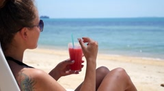 Beach Woman Drinking Cold Exotic Drink Beverage on Vacation Arkistovideo
