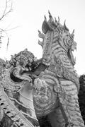asian traditional design of guarding lion statue - stock photo