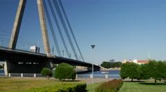 Small cruise ship sailing to the Vanšu Bridge in Riga - stock footage
