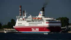 Tallink ferry leaving Riga Latvia with a small cruise ship next to it Stock Footage