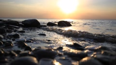 Pebble Beach and waves during amazing sunset. Have a sound of splashes Of waves Stock Footage