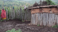 Poor African village mud house with children Stock Footage