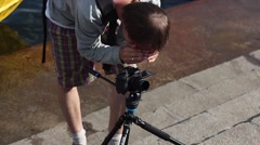 Young shoots video operator on the river bank in the super-high resolution - stock footage