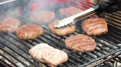 Big, lush, delicious cutlets to fried burgers on the grill fire close-up Stock Footage