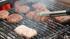 Large pieces of meat roasted on the fire during the festival food close up Stock Footage