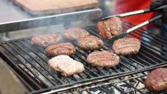 Smoking grill on which the meat is fried burger during a picnic Stock Footage