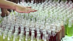 Small colorful alcoholic drinks are available at the festival of food drink Stock Footage