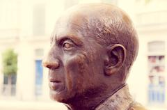 MALAGA, SPAIN - FEBRUARY 08: Pablo Picasso statue in Merced Square on Februar Stock Photos