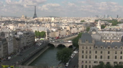 Aerial view of the City of Paris with the Eiffel Tower in the distance. - stock footage