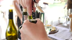 Open a bottle of sparkling wine with a corkscrew Stock Footage