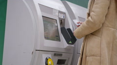 4k, young, attractive female purchasing train ticket from machine - stock footage