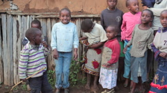 Happy children next to mud house smile, Samburu, Kenya, Africa Stock Footage