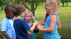 Children looking at glass container Stock Footage