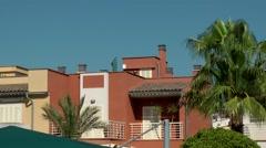 Spain Mallorca Island Cala Blava 025 colorful spanish row house and palm trees Stock Footage