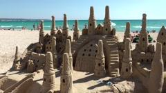 Spain Mallorca Island Playa de Palma 002 giant sandcastle on white sandy beach Stock Footage