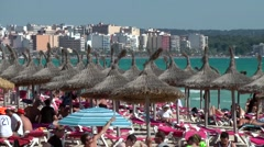 Spain Mallorca Island Playa de Palma 004 Arenal beach with straw sunshades Stock Footage