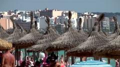 Spain Mallorca Island Playa de Palma 005 Arenal skyline behind beach sunshades Stock Footage