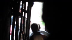 Exiting poor village mud house in Africa, Samburu, Kenya Stock Footage