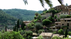 Spain Mallorca Island various 050 houses and gardens of village Deia at hillside Stock Footage