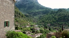 Spain Mallorca Island various 051 village Deia houses and gardens at hillside Stock Footage