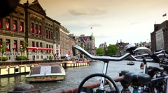 ULTRA HD 4k, Real time; Boats sail in Amsterdam canal - stock footage