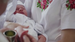Little girl on ceremony of child christening in church - stock footage