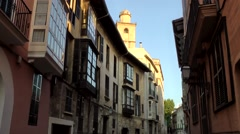 Spain Palma de Mallorca 119 travel group in a shady old town alley Stock Footage