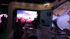 4k LED video walls fair and exhibition panning with visitors - stock footage