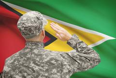 National military forces with flag on background conceptual series - Guyana Stock Photos
