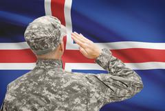 National military forces with flag on background conceptual series - Iceland - stock photo
