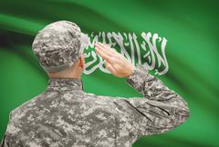 National military forces with flag on background conceptual series - Saudi Ar - stock photo