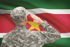 National military forces with flag on background conceptual series - Suriname - stock photo