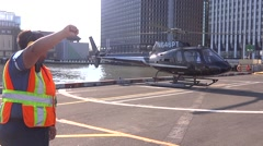 Heliport worker directing pilot Stock Footage