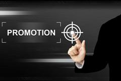 business hand pushing promotion button on touch screen - stock photo