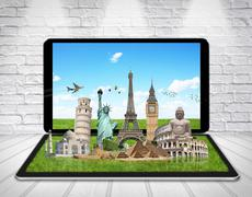 Monuments of the world on a tactile tablet - stock illustration