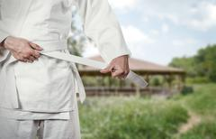 Karate master prepares for combat in high mountain village - stock photo