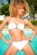 Adorable Girl Posing in White Bikini Stock Photos