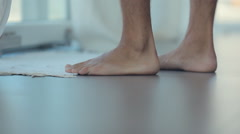 Close-up of men's feet going barefoot on a floor Stock Footage