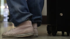The legs of a woman with a suitcase. Stock Footage