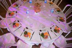Banquet wedding table setting on evening reception Stock Photos