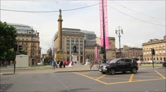 14 June, 2015, visitors walking in the George Square in Glasgow, Scotland Stock Footage