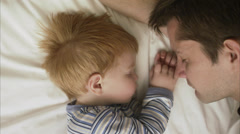 Father and son sleeping, Sweden. Stock Footage