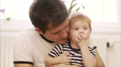 Father sitting with his son, Sweden. Stock Footage