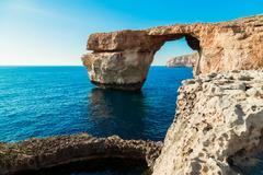 Azure Window, famous stone arch of Gozo island in the sun in summer, Malta Stock Photos