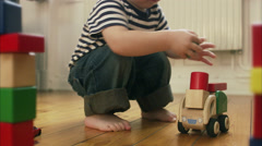 Boy playing with a toy car, Sweden. Arkistovideo